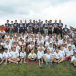 Abington Heights High School football players help youngsters with basics at Junior Comets Camp