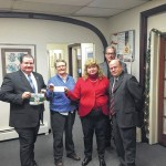 O'Malley family presents $1,000 check to Women's Resource Center