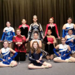 Double 'R' Twirlettes members perform at high school football games