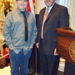 Camera For A Cure founder, photographer Timmy Walsh volunteers with Judge Michael Barrasse