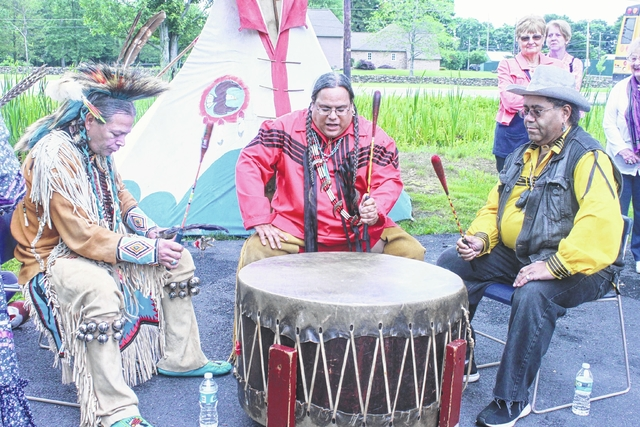 Robert Boldeagle, Jerry Greyhawk and Edward Sunwolf, all members of the Red Storm Drum & Dance Troupe, provided the crowd with dance, drumming and song at a Native American Pow Wow held July 15 at the Abington Community Library.