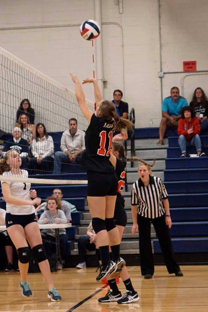 Lackawanna Trail's Laurelann Penn sets up for a block during a girls volleyball match against Abington Heights Sept. 8.