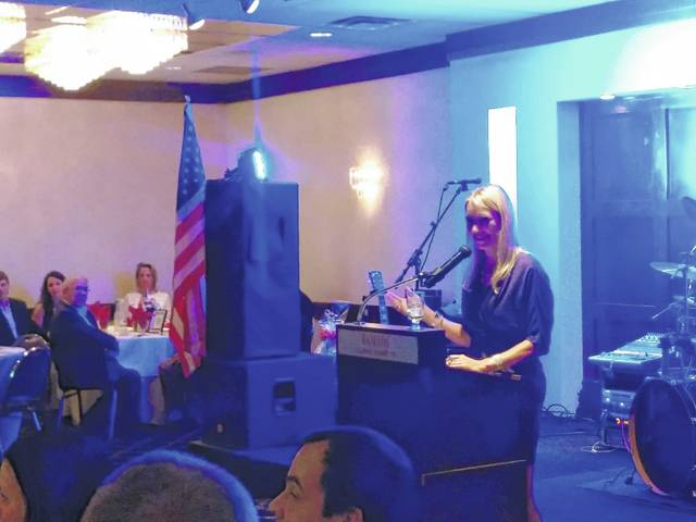 Nancy Antinnes Curra, master of ceremonies of the event and one of the organizers of the ASAP committee, acknowledges first responders of the Abington area.