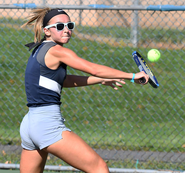 Lauren Koczwara hits a slice backhand for Abington Heights in her match at No. 3 singles against Williamsport's Kalindi Maggs. (Tony Callaio | For Abington Journal)