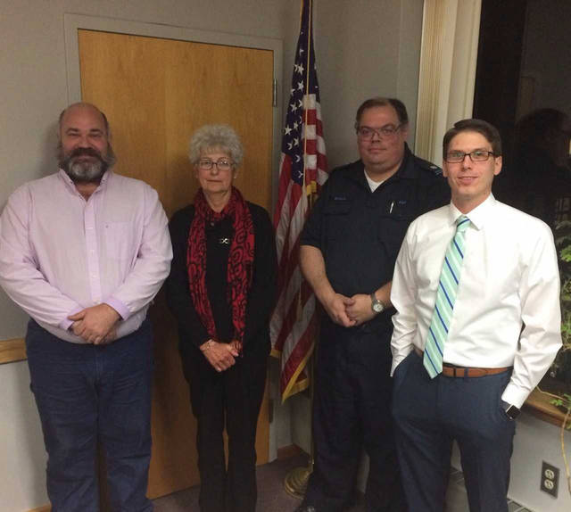 The Lackawanna Trail School District held a reorganization meeting Dec. 4. From left, Kevin Mulhern, Deborah Naylor, Adrian Bianchi and Philip Stark were sworn in as members of the board of education by Wyoming County District Justice David K. Plummer.