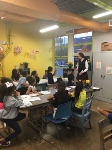 Stephanie Yatko teaches the children at the Boys and Girls Club STEM program about space.