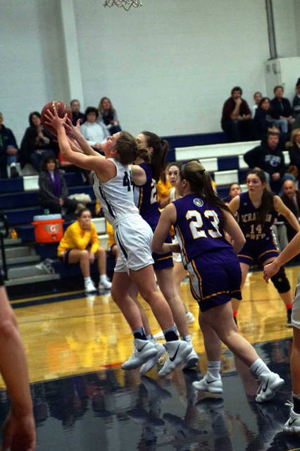 Abington Heights' Erin Albright, left, and Scranton Prep's Elisa Penetar battle for a rebound during a Lackawanna League Division 1 girls basketball game Jan. 8.