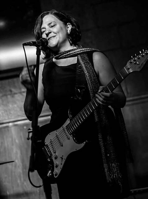 Phyllis Hopkins is known for her unique voice and fiery guitar solos, and has released two independent CDs of her own music.