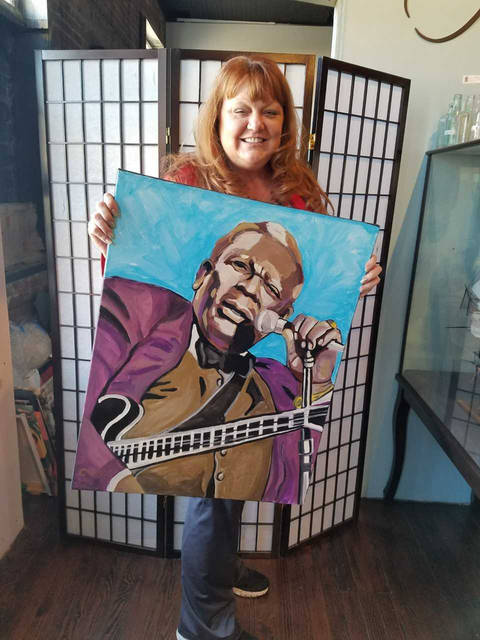 Featured artist Catrina King, a Tunkhannock resident, paints on recycled materials such as barn wood, old roofing tin and old LP records.