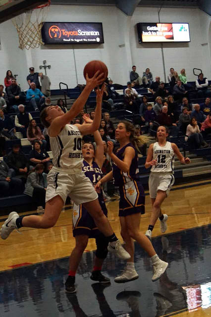 Abington Heights' Hannah Kowalski goes up for a reverse layup as Scranton Prep's Kathleen Rose defends during a Lackawanna League Division 1 girls basketball game Jan. 8.