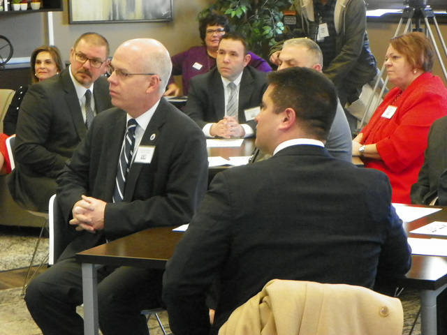 Abington Heights Superintendent Michael Mahon and Principal Andrew Snyder, front, attended a roundtable discussion at Lackawanna College April 5. The school district is one of four partnering with the college for the Level Up Lackawanna program.