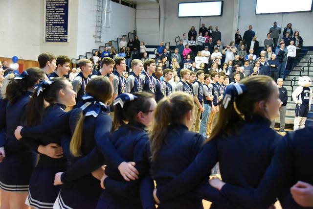 Abington Heights boys basketball players and cheerleaders line the court during a Night of Champions April 4.