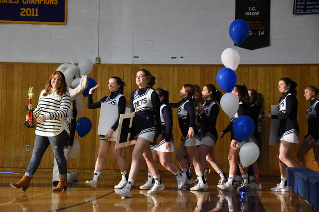 Members of the Abington Heights boys basketball cheerleaders make their way on the court during a Night of Champions April 4 at the high school.