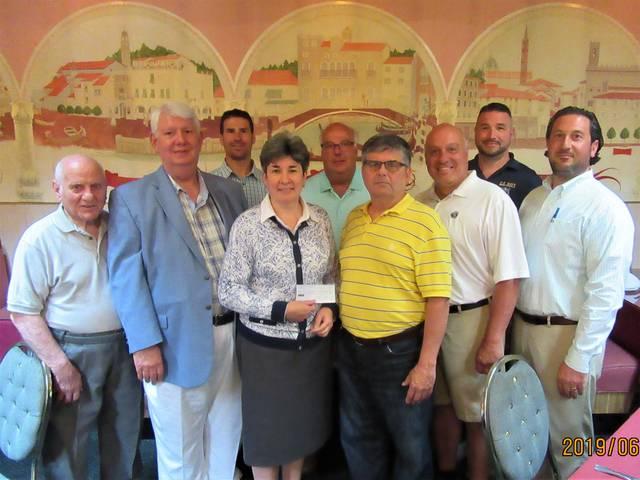 Columbus Day Association presents donation to St. Joseph's Center