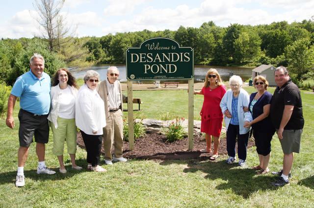 Commissioners rededicate pond at Covington Park to DeSandis family