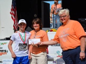 Sixth-grader Vincent O'Malley receives first-place medal at Minicozzi Race