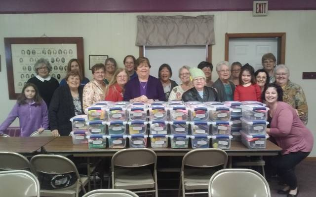 Five Eastern Star chapters make activity boxes of school supplies
