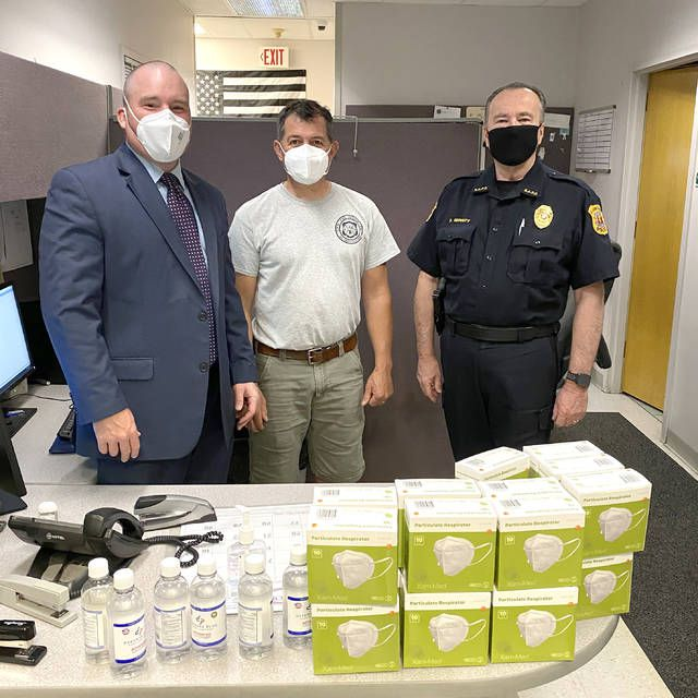 Rep. Mary Flynn recently donated 250 masks and hand sanitizer to the Chinchilla Hose Company and police department.                                  Submitted photo