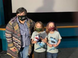 """Dr. Linda Auker, left, with twins Logan and Zane Gonzalez, of Bloomsburg, discussing their interest in sharks after the Dietrich's free Science on Screen program """"Confronting Jaws: Why We Should Love Sharks, Not Fear Them.""""                                  Submitted photo"""