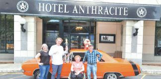 From left are Linda Oliveri, Coal Cracker Cruisers Car Club; Chad Coble, Director of Sales, Hotel Anthracite; Joann Spalnick and Mike Spalnick, Coal Cracker Cruisers Car Club.                                  Submitted photo