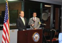 U.S. Sen. Pat Toomey, R-Lehigh Valley, left and Luzerne County District Attorney Sam Sanguedolce discuss the senator's 'Thin Blue Line Act' during a press conference at the Wilkes-Barre City Police Department headquarters Thursday. The legislation would make the murder of a federal law enforcement officer a factor for a jury to consider before imposing the death penalty. Toomey said he will reintroduce the bill next week.                                  Jerry Lynott | Times Leader