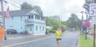 David Haines, of Madisonville, becomes the first person to finish the Dalton Dash.                                  Ben Freda   For Abington Journal