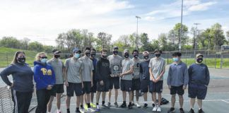 The Abington Heights boys tennis team receives its District 2 Class 3A championship plaque at Kirby Park in Wilkes-Barre.                                  Tom Robinson | Abington Journal