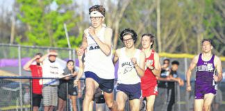 Tyler Petty holds off several other contenders on his way to winning the District 2 Class 3A 800-meter title.                                  Zachary Allen | Abington Journal