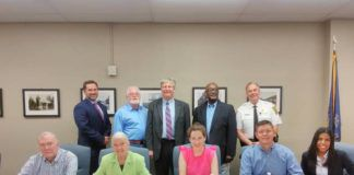 Clarks Summit Council members in the new council chambers. Front row, from left, are councilman Harry Kelly, council president Gerrie Carey, councilwoman Kathleen Simrell, councilman Josh Mitchell, and councilwoman Roni Lopez. Back row, from left, are solicitor Kevin Hayes, councilman David Jenkins, councilman Bob Shiels, mayor Herman Johnson, and police chief Chris Yarns.                                  Submitted photo
