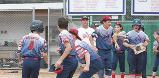 Ethan Aftewicz (4) is greeted at home plate hitting a solo home run in the bottom of the seventh inning to give Greater Pittston Area a 5-4 victory over Abington in the Section 5 Little League Major Baseball championship game Tuesday at Back Mountain Little League.                                  Tony Callaio | For Times Leader