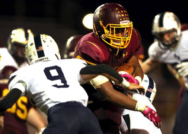 <p>Wyoming Valley West running back Isaiah Cobb picks up yardage in the second quarter against Abington Heights on Friday night at Spartan Stadium in Kingston.</p>                                  <p>Fred Adams   For Times Leader</p>