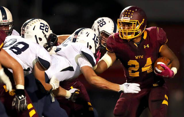 Wyoming Valley Westrunning back Isaiah Cobb looks for yardage against Abington Heights in the second quarter Friday night at Spartan Stadium in Kingston. Cobb scored three touchdowns to lead the Spartans past the Comets 21-14.                                  Fred Adams   For Times Leader