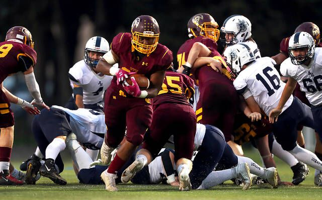 <p>Wyoming Valley West running back Isaiah Cobb runs through a hole in the Abington Heights defense in the second quarter Friday night at Spartan Stadium in Kingston.</p>                                  <p>Fred Adams   For Times Leader</p>
