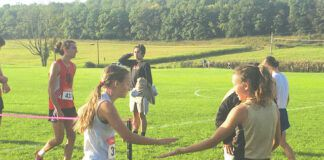 Third-place finisher Maia Arcangelo from Abington Heights, left, greets second-place finisher Madison Kammer from Western Wayne following the Sept. 28 Lackawanna League meet at the Abington Heights Middle School.                                  Tom Robinson | For Abington Journal